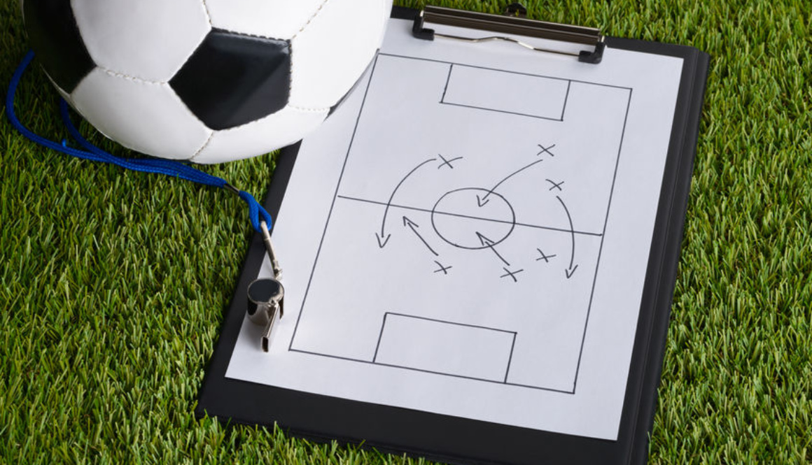 35690141 - ball; whistle and soccer tactic diagram on paper over pitch